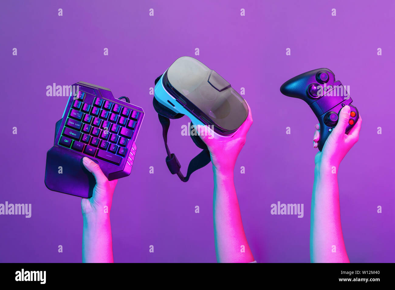 Set of hands with gamepad, keyboard, virtual reality headset