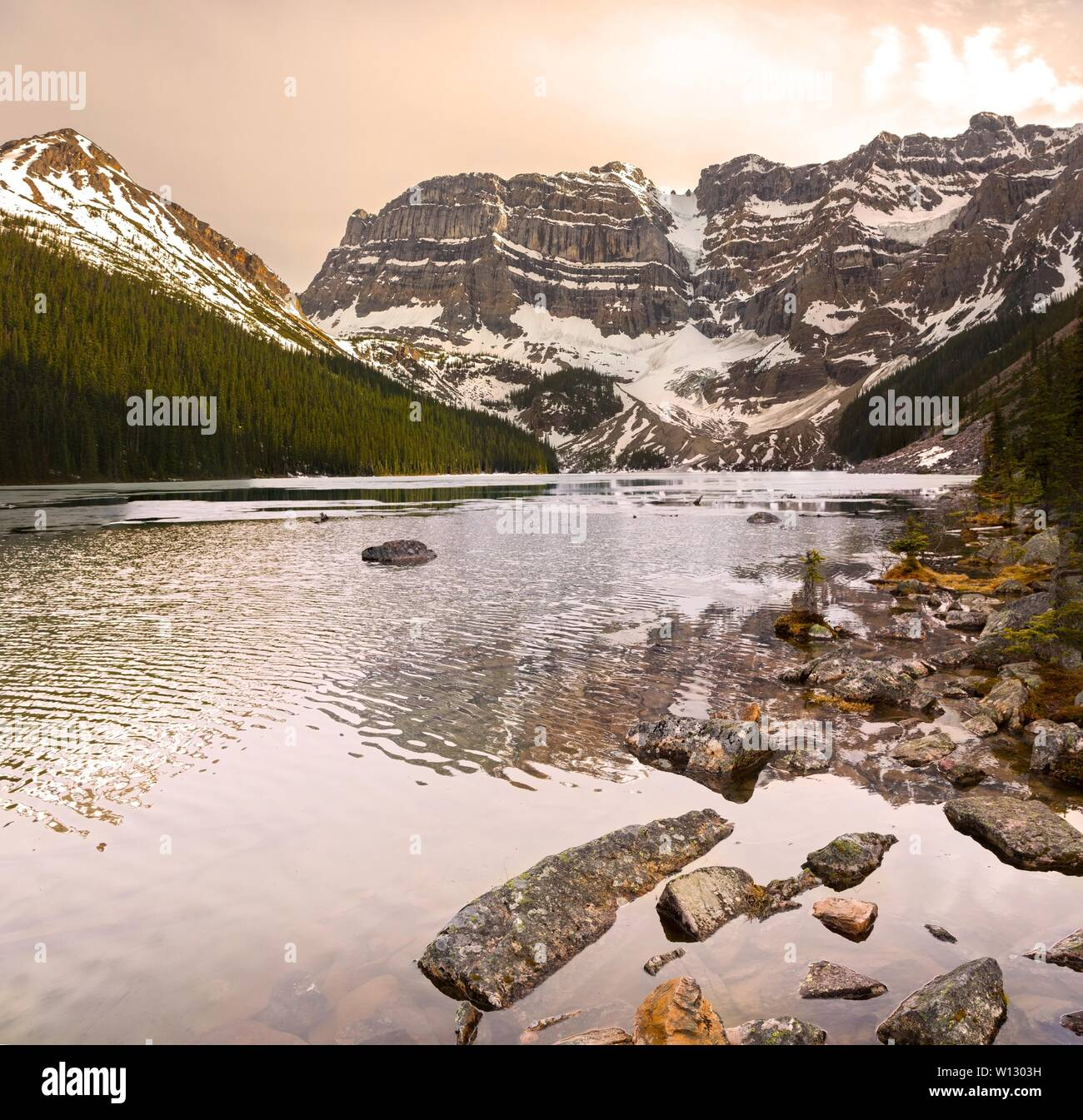 Vertical Panoramic Landscape View of Scenic Cirque Lake and Rugged Mountain Peaks in Banff National Park near Icefields Parkway, Canadian Rockies Stock Photo