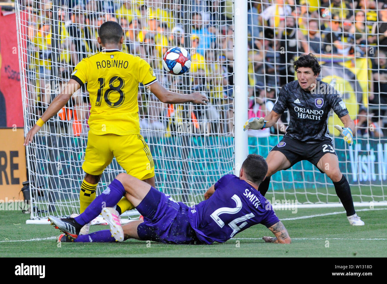 Saturday, June 29, 2019: Columbus Crew SC forward Robinho (18) takes a shot while Orlando City defender Kyle Smith (24) attempt to block the first half of the match between Orlando City and Columbus Crew SC at MAPFRE Stadium, in Columbus OH. Mandatory Photo Credit: Dorn Byg/Cal Sport Media. Orlando City 1 - Columbus Crew SC 0 after the first half - Stock Image