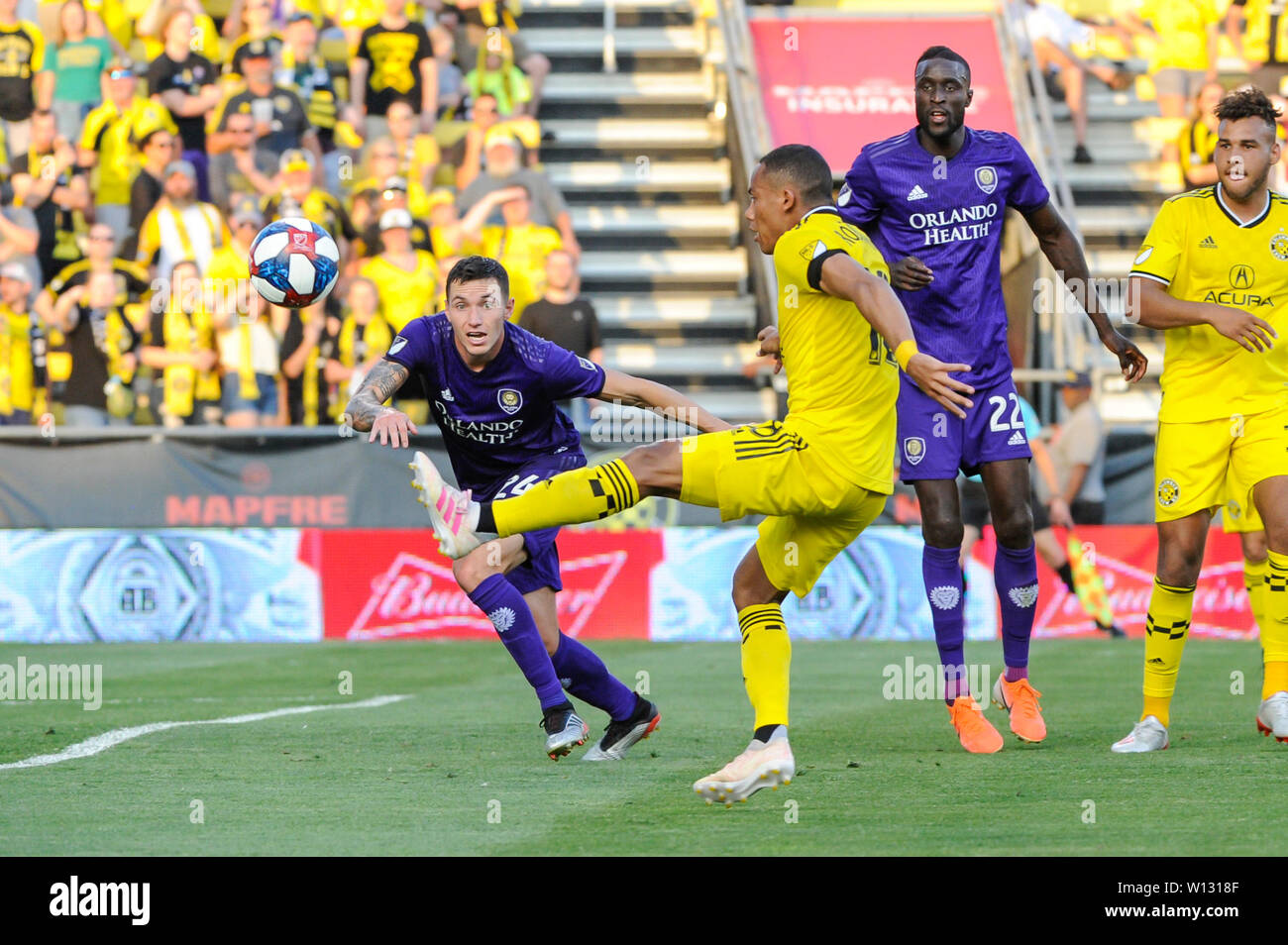 Saturday, June 29, 2019: Columbus Crew SC forward Robinho (18) attempts to connect on a cross with Orlando City defender Kyle Smith (24) looking on in the first half of the match between Orlando City and Columbus Crew SC at MAPFRE Stadium, in Columbus OH. Mandatory Photo Credit: Dorn Byg/Cal Sport Media. Orlando City 1 - Columbus Crew SC 0 after the first half - Stock Image