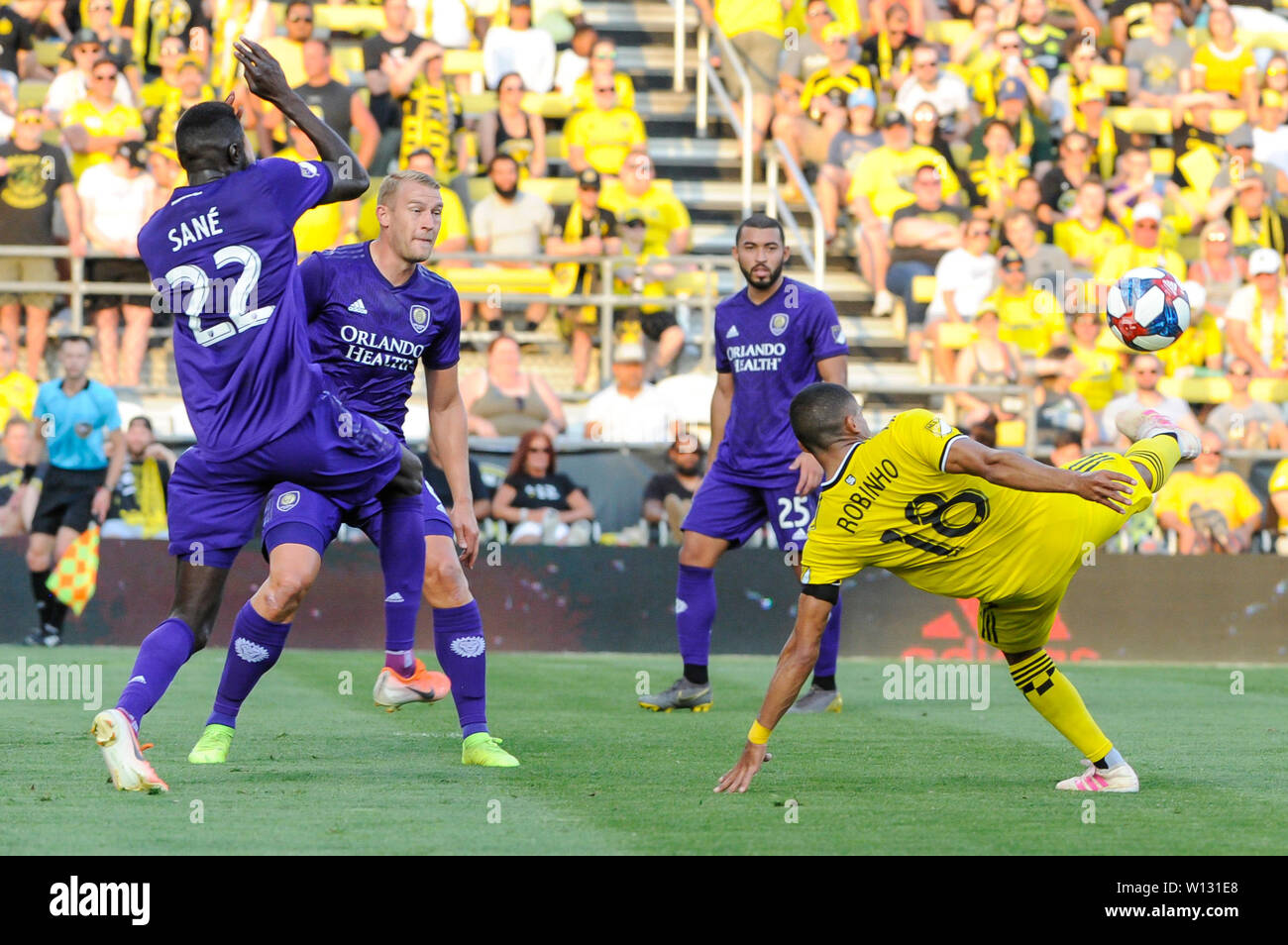 Saturday, June 29, 2019: Columbus Crew SC forward Robinho (18) attempts a bicycle kick while Orlando City defender Lamine Sane (22) protects his face the first half of the match between Orlando City and Columbus Crew SC at MAPFRE Stadium, in Columbus OH. Mandatory Photo Credit: Dorn Byg/Cal Sport Media. Orlando City 1 - Columbus Crew SC 0 after the first half - Stock Image