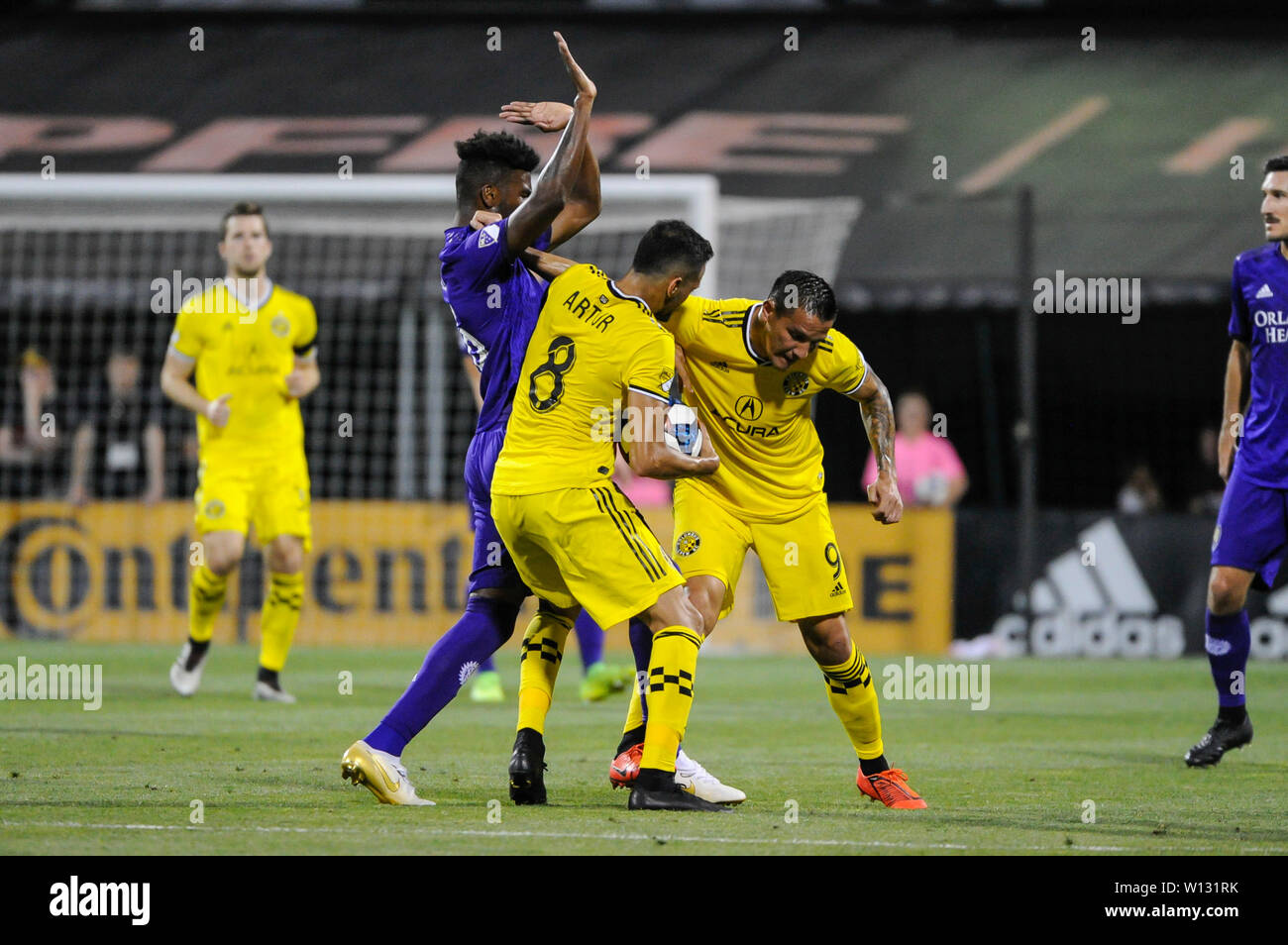 Saturday, June 29, 2019: Orlando City defender Carlos Ascues (26) books the ball attempting to use up time resulting in a yellow card in the first half of the match between Orlando City and Columbus Crew SC at MAPFRE Stadium, in Columbus OH. Mandatory Photo Credit: Dorn Byg/Cal Sport Media. Orlando City 2 - Columbus Crew SC 0 at the end of the match - Stock Image
