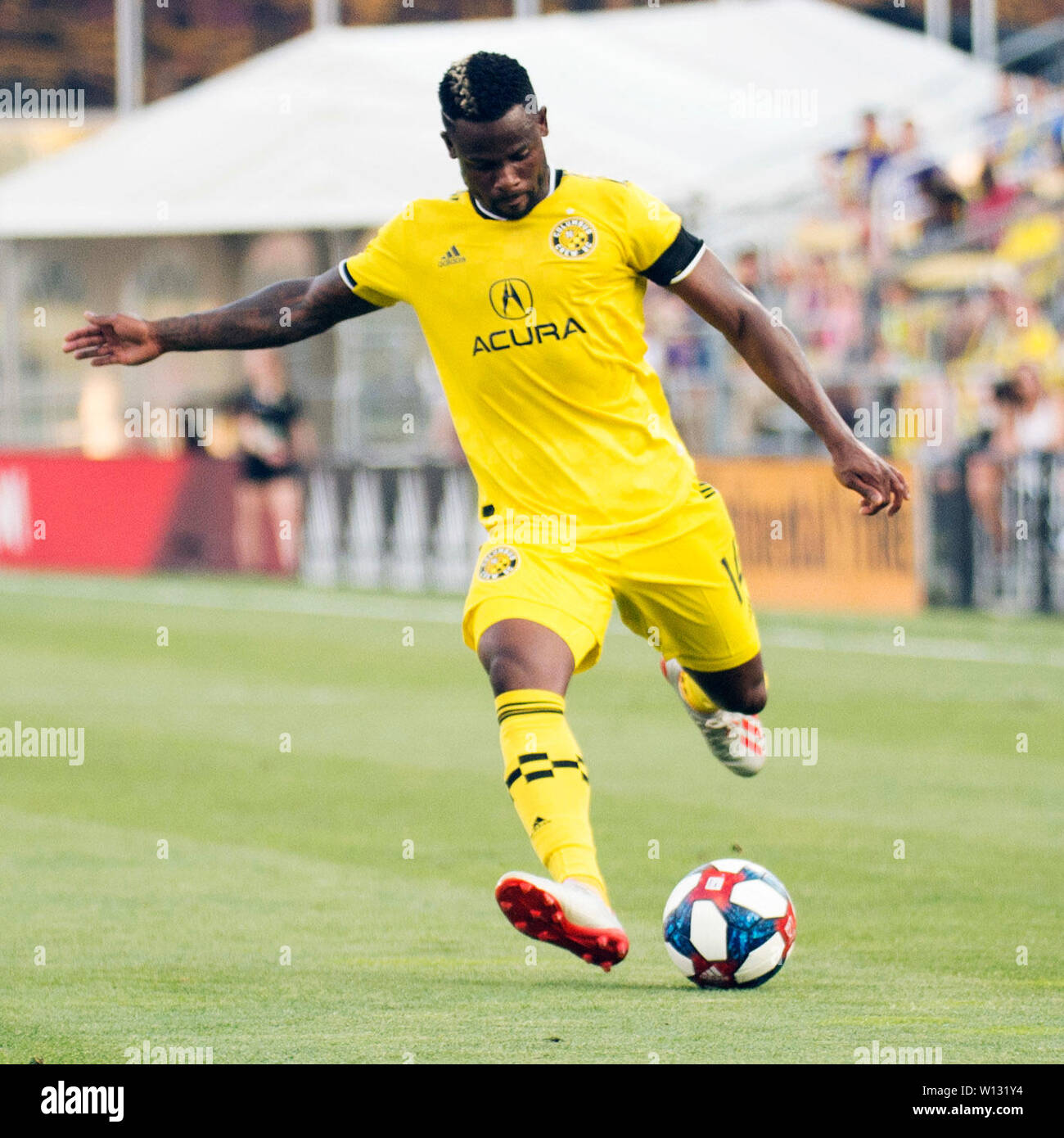 June 29, 2019: Columbus Crew SC defender Waylon Francis (14) sends the ball down the pitch against Orlando City in their game in Columbus, Ohio, USA. Brent Clark/Alamy Live News - Stock Image