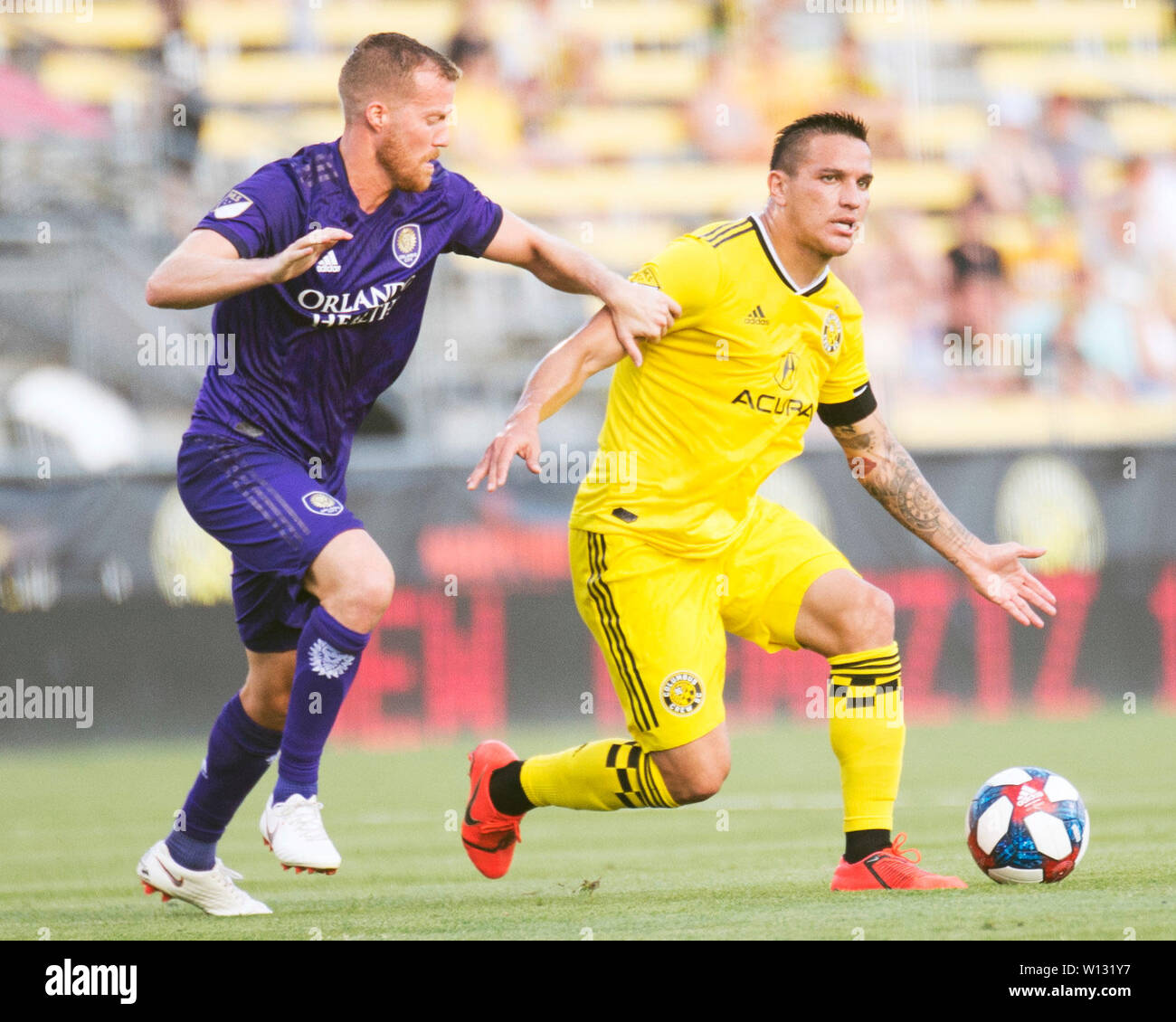 June 29, 2019: Columbus Crew SC midfielder David Guzman (9) fights for the ball against Orlando City midfielder Oriol Rosell (20) in their game in Columbus, Ohio, USA. Brent Clark/Alamy Live News - Stock Image