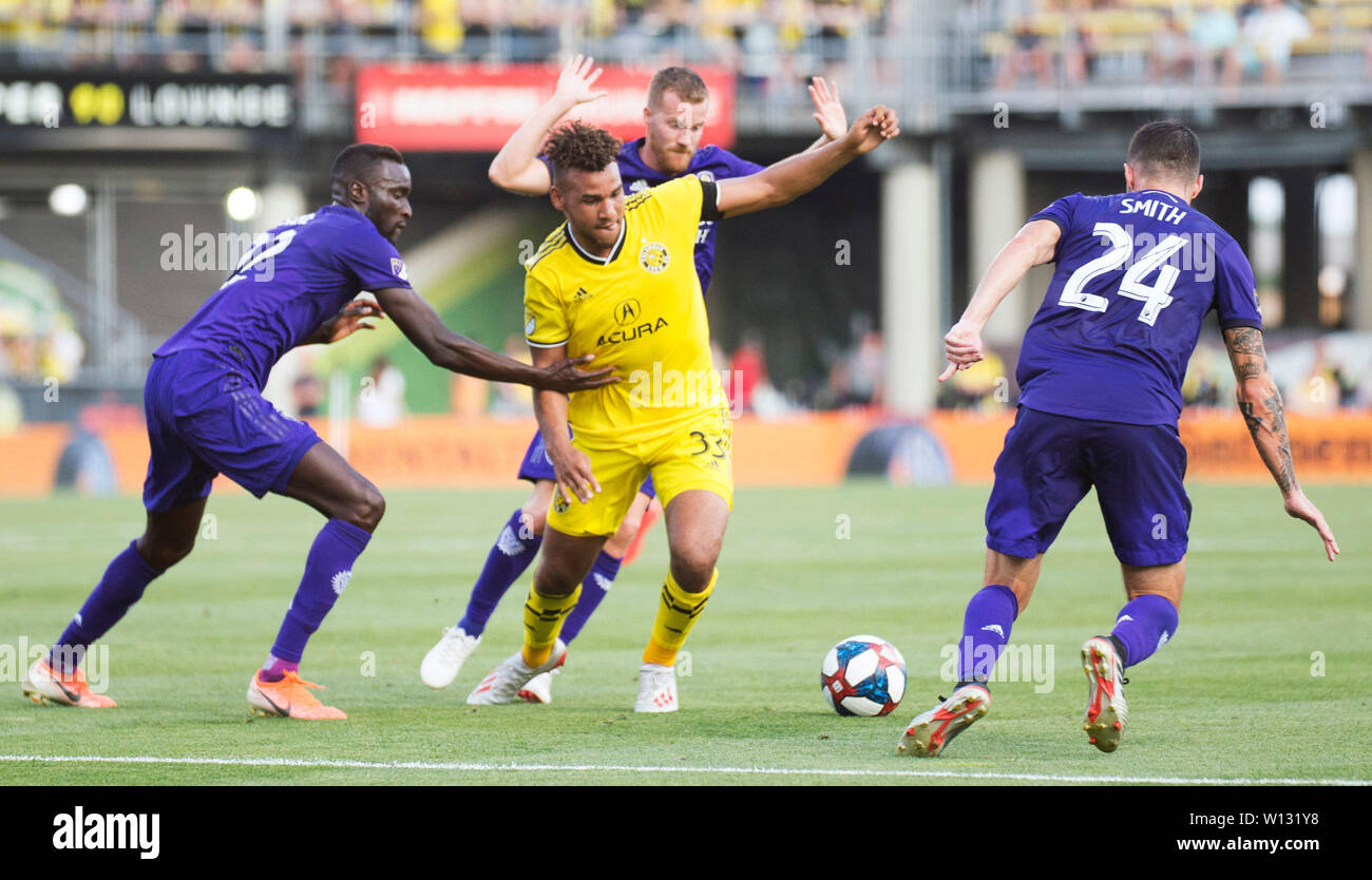 June 29, 2019: Columbus Crew SC forward JJ Williams (yellow) fights for the ball against the Orlando defense in their game in Columbus, Ohio, USA. Brent Clark/Alamy Live News - Stock Image