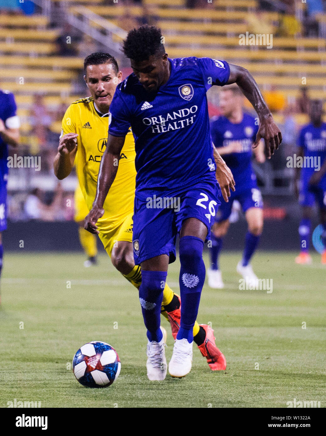 June 29, 2019: Orlando City defender Carlos Ascues (26) handles the ball against the Columbus Crew SC defense in their game in Columbus, Ohio, USA. Brent Clark/Alamy Live News - Stock Image