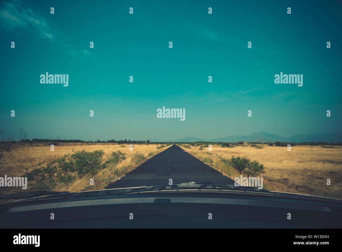Road pavement under blue sky Stock Photo
