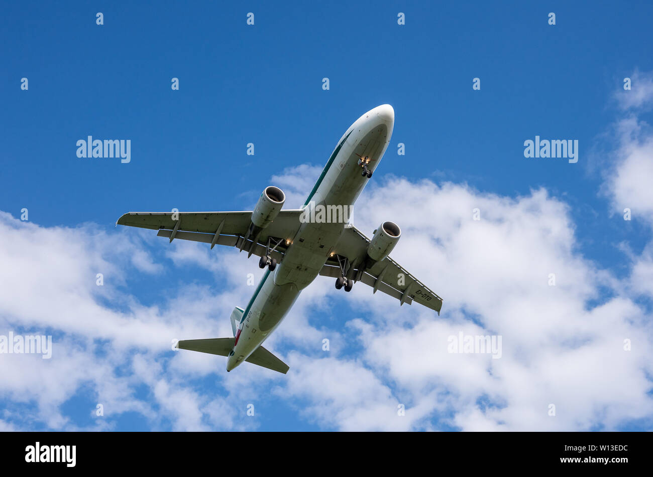 Alitalia Airbus A320-200 landing in Bulgaria; Airbus A320 landing gear seen from bellow - Stock Image