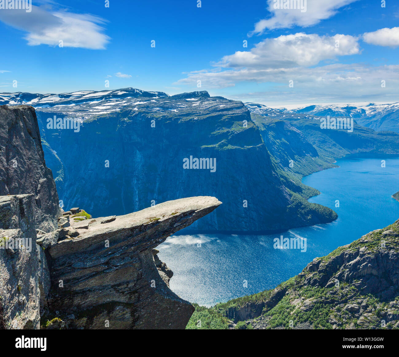The summer view of Trolltunga (famous The Troll's tongue Norvegian destination) and Ringedalsvatnet lake in Odda, Roldal, Norway. - Stock Image