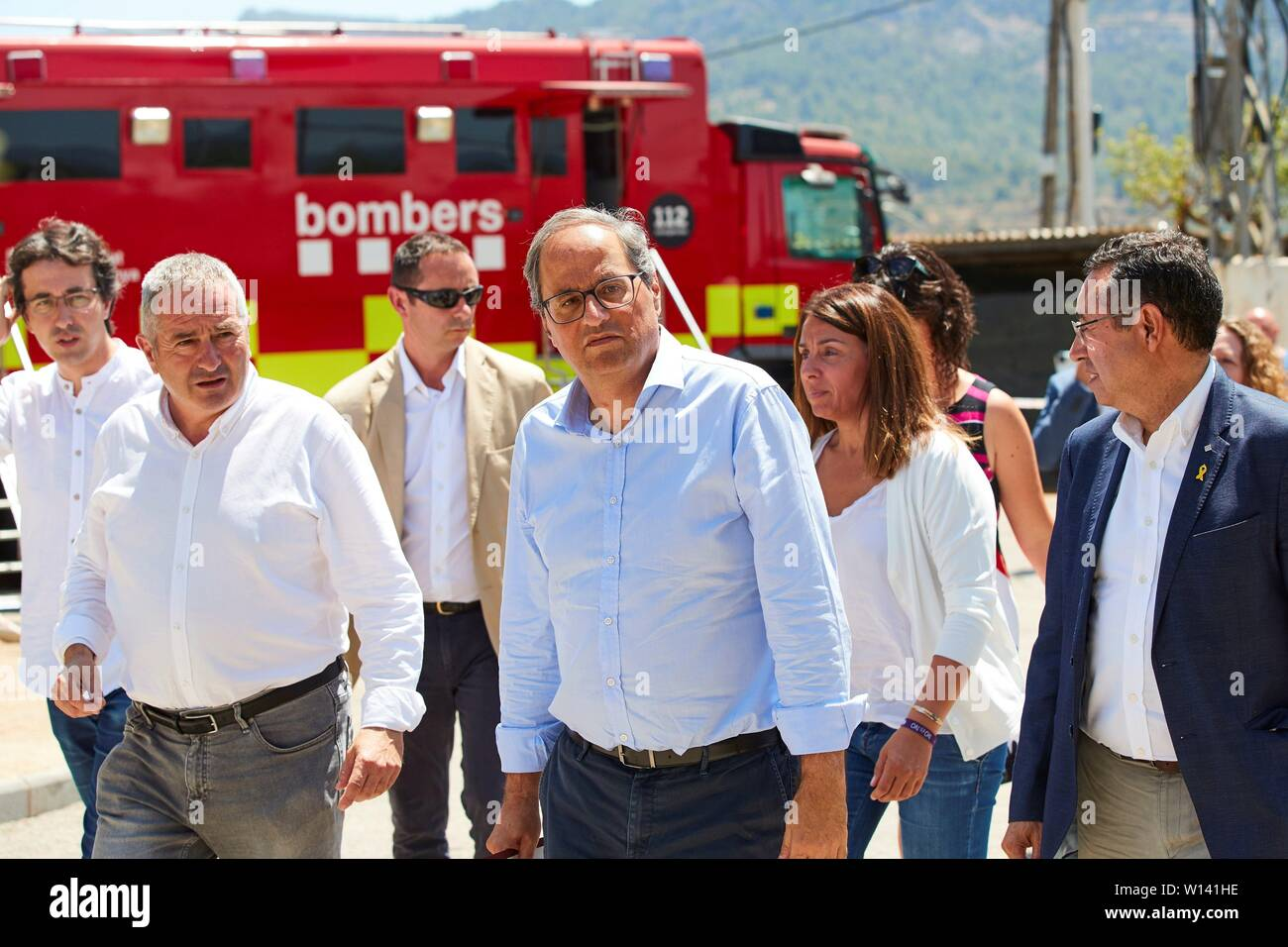 Tarragona, Spain. 30th June, 2019. Catalan regional President, Quim Torra (C), during meeting with mayors of towns in Ribera d'Ebre local administrative division in Vinebre town, Tarragona, Spain, 30 June 2019, to analyze the situation that caused the fire declared 26 June 2019 that burnt more than 6,000 hectares of land. Credit: EFE News Agency/Alamy Live News - Stock Image