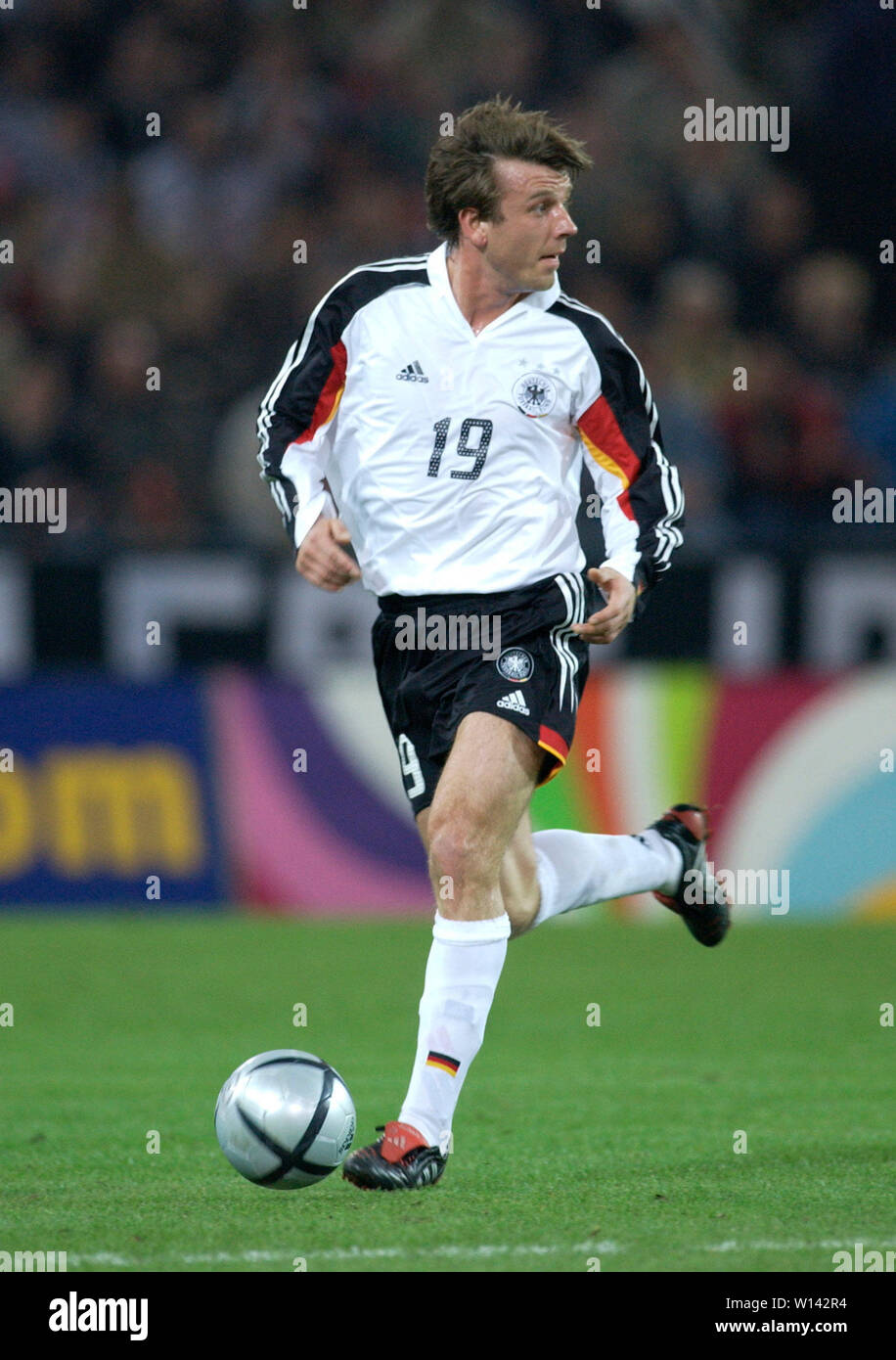 Rhein-Energie-Stadion Cologne Germany, 31.3.2004, Football: International friendly, Germany (white) vs. Belgium (red) 3:0 --- Bernd Schneider (GER) Stock Photo