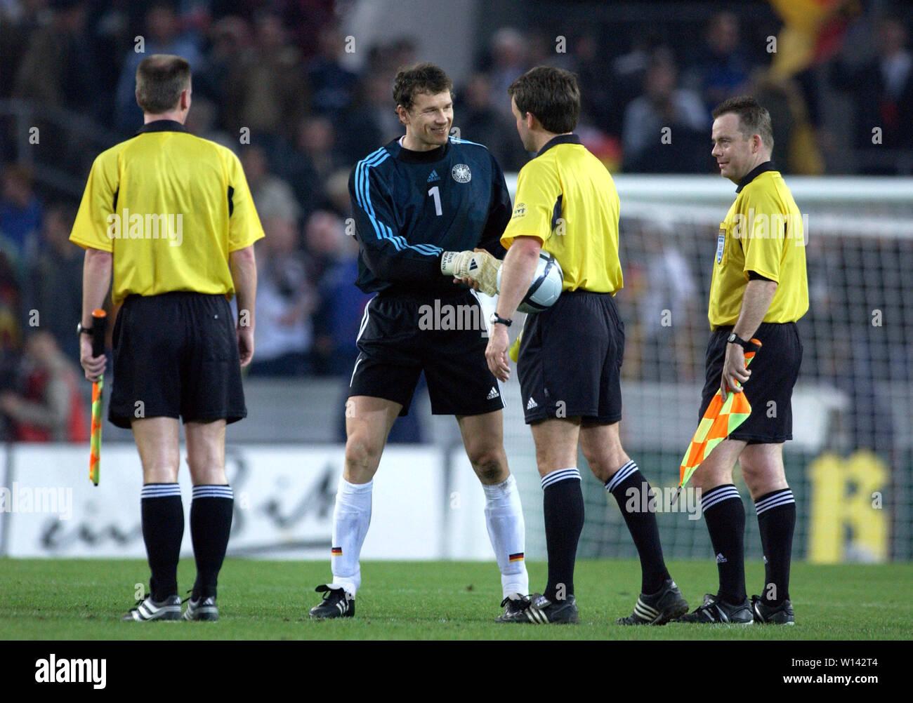 Rhein-Energie-Stadion Cologne Germany, 31.3.2004, Football: International friendly, Germany (white) vs. Belgium (red) 3:0 --- goalkeeper Jens Lehmann  (GER) shakes hands with referee Jan Wegereef (NED) Stock Photo
