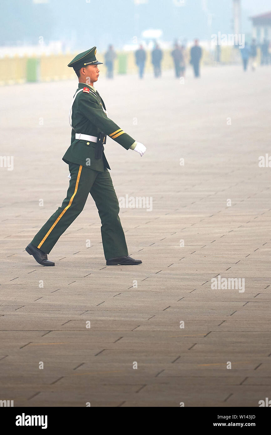 A Young Peoples Republic Of China Soldier, Marches Across Tiananmen Square, Beijing, Peoples Republic Of China. Stock Photo