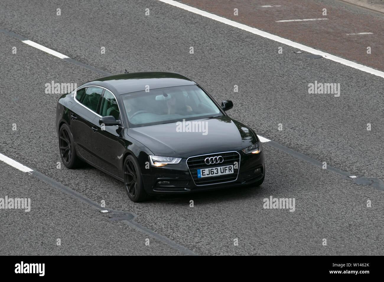 2013 black Audi A5 SE Technik TDI; M6, Lancaster, UK; Vehicular traffic, transport, modern, saloon cars, north-bound on the 3 lane highway. - Stock Image