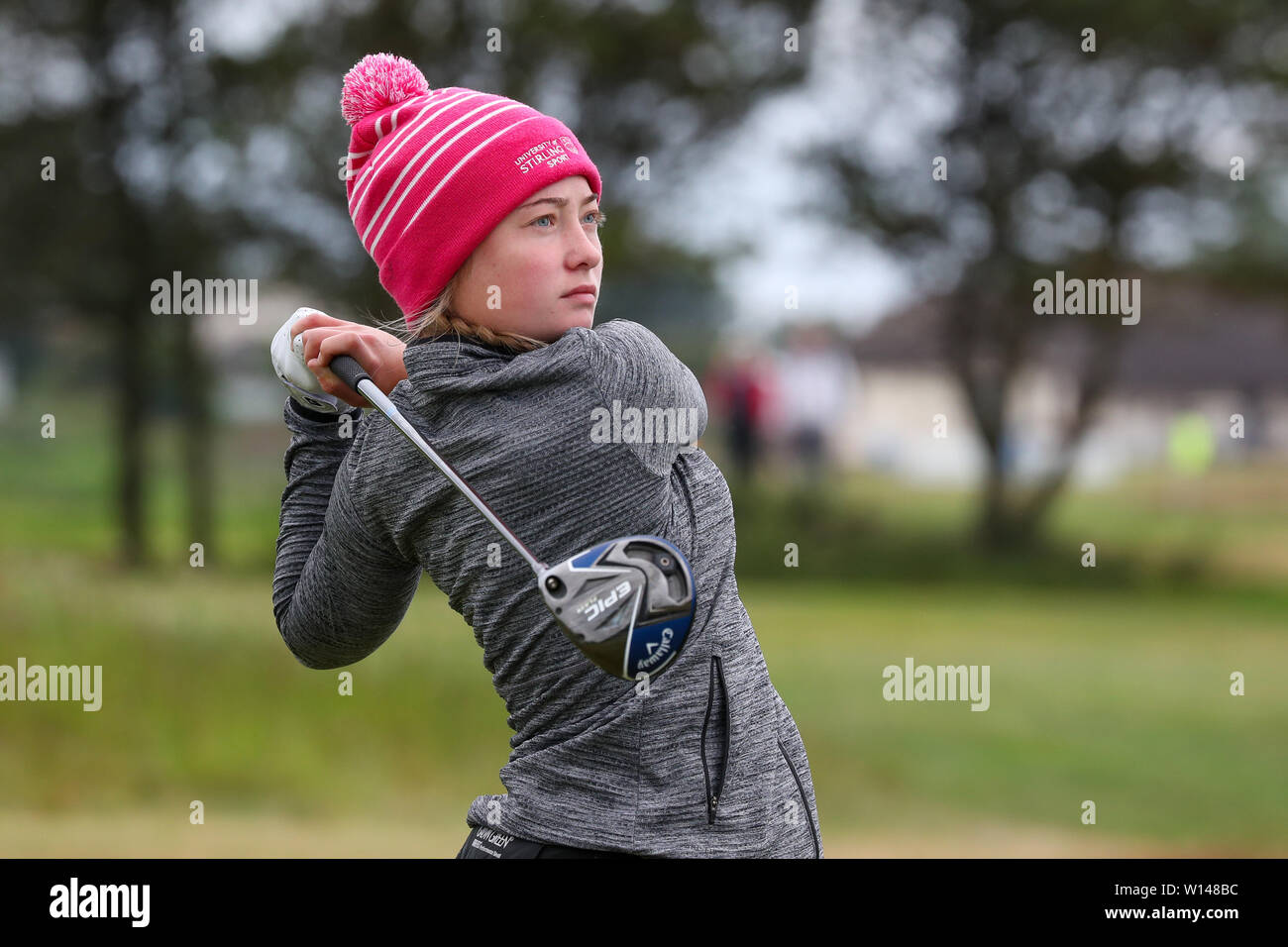 Troon, Scotland, UK. 30th June 2019. On the final day of the Competition the remaining 8 golfers, playing matchplay golf competed over Barassie Links Golf course, Troon in blustery wind and squally rain conditions to try and win the Championship Cup and the Clark Rosebowl. Image of JENNIFER RANKINE representing Haggs Castle GC teeing off at the 15th Credit: Findlay/Alamy Live News - Stock Image