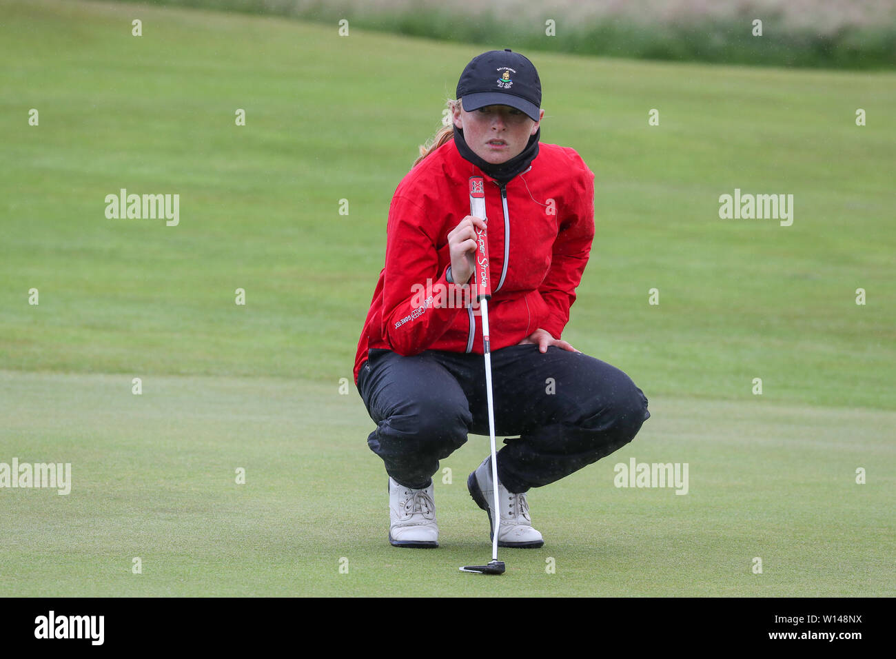 Troon, Scotland, UK. 30th June 2019. On the final day of the Competition the remaining 8 golfers, playing matchplay golf competed over Barassie Links Golf course, Troon in blustery wind and squally rain conditions to try and win the Championship Cup and the Clark Rosebowl. Credit: Findlay/Alamy Live News - Stock Image