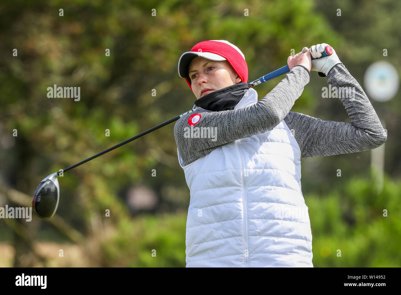 Troon, Scotland, UK. 30th June 2019. On the final day of the Competition the remaining 8 golfers, playing matchplay golf competed over Barassie Links Golf course, Troon in blustery wind and squally rain conditions to try and win the Championship Cup and the Clark Rosebowl. Image of TARA MACTAGGART representing Minto Golf Club teeing off at the 17th Credit: Findlay/Alamy Live News - Stock Image
