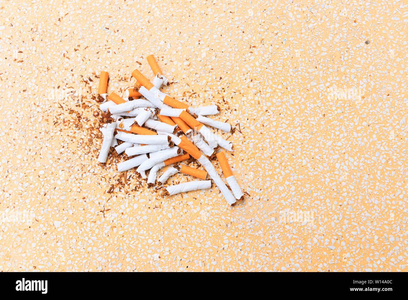Pile Cigarettes Broken On Table Terrazzo Flooring Yellow