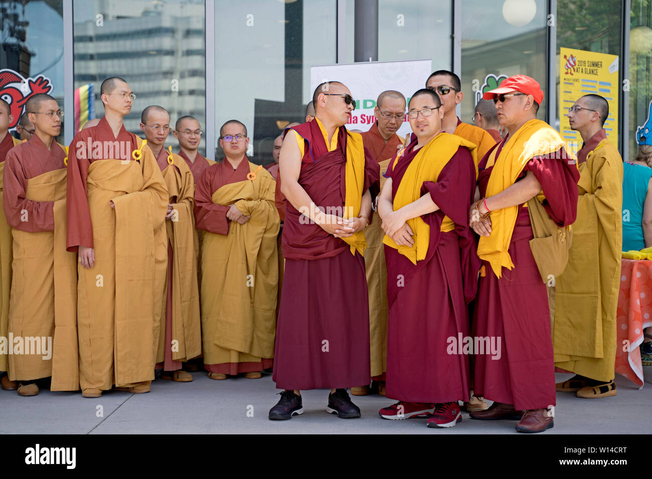 Buddhist Monks gathered for Vesak Celebration of Buddha's Birthday, Mississauga Ontario Canada, 26 May 2019 - Stock Image