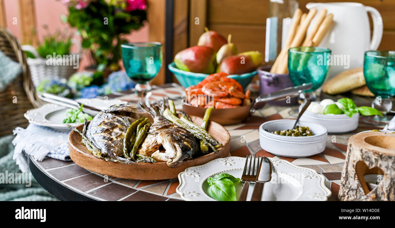 Fried Fish On A Plate Dining Table With Different Food And