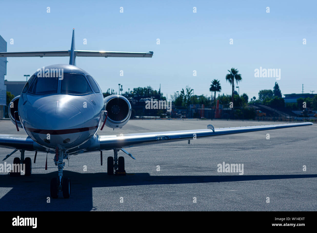 Luxury private jet is parked on an airfield at dusk Stock Photo