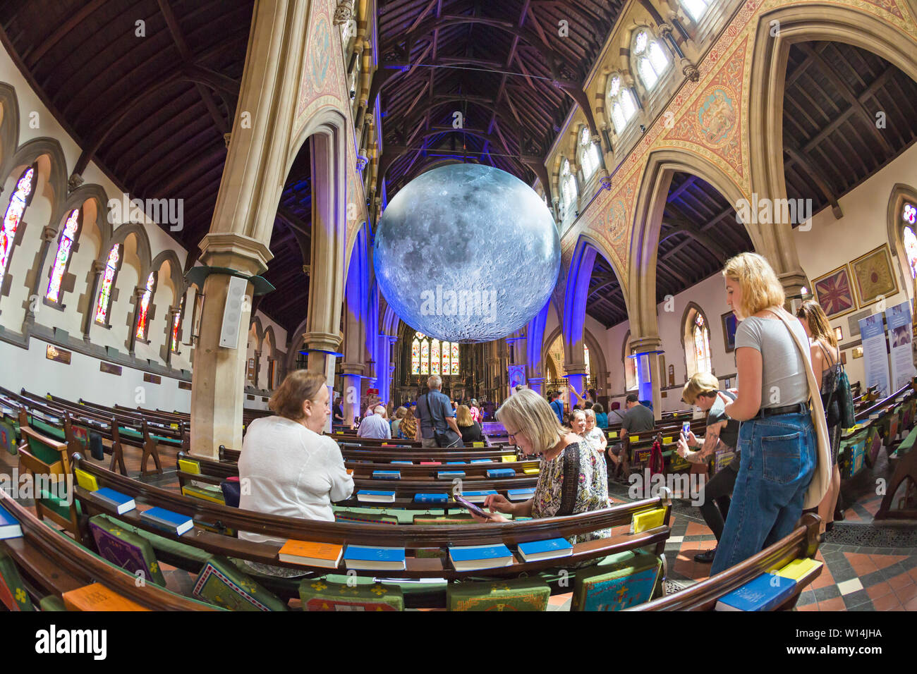 Bournemouth, Dorset, UK. 30th June, 2019. Dorset Moon, a celebration of the first moon landing 50 years ago featuring Luke Jerram's internationally acclaimed Museum of the Moon measuring 7meters in diameter. A full programme of free lunar-inspired events creating an experience that is out of this world takes place in St Peters Church. Taken with a fish-eye lens. Credit: Carolyn Jenkins/Alamy Live News - Stock Image