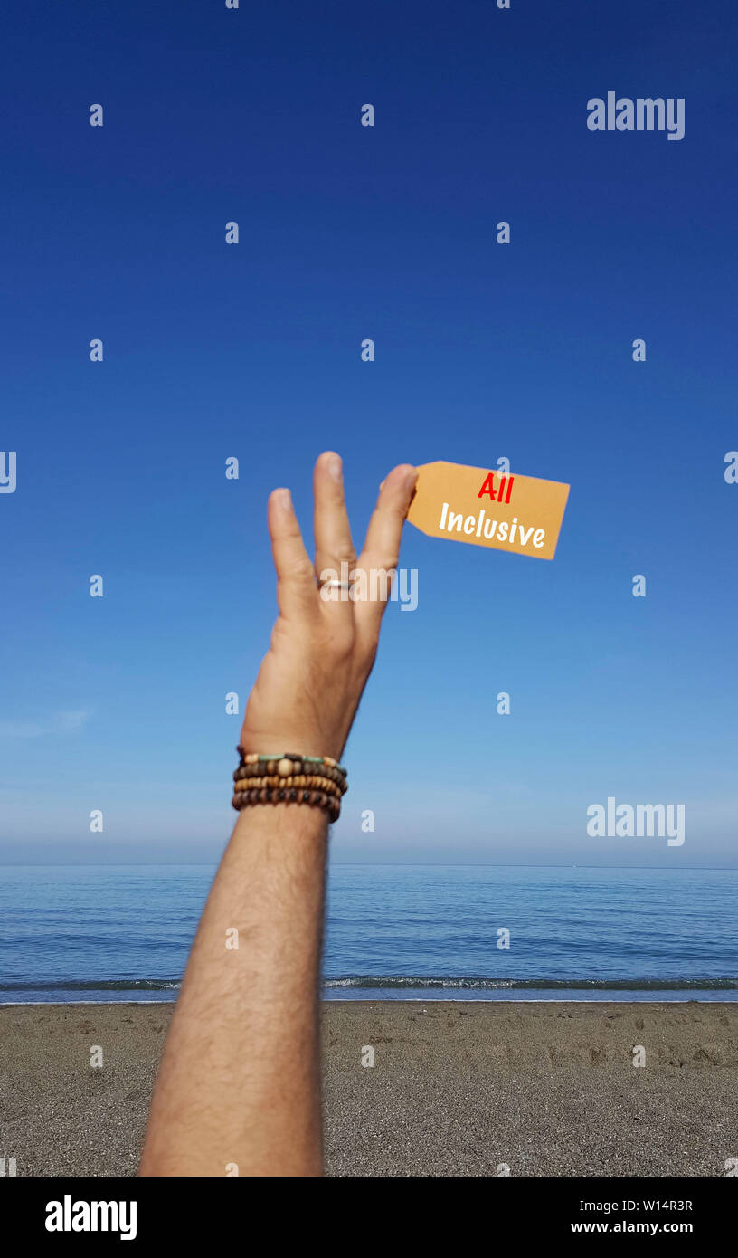 Tag on the beach with text All inclusive - Stock Image