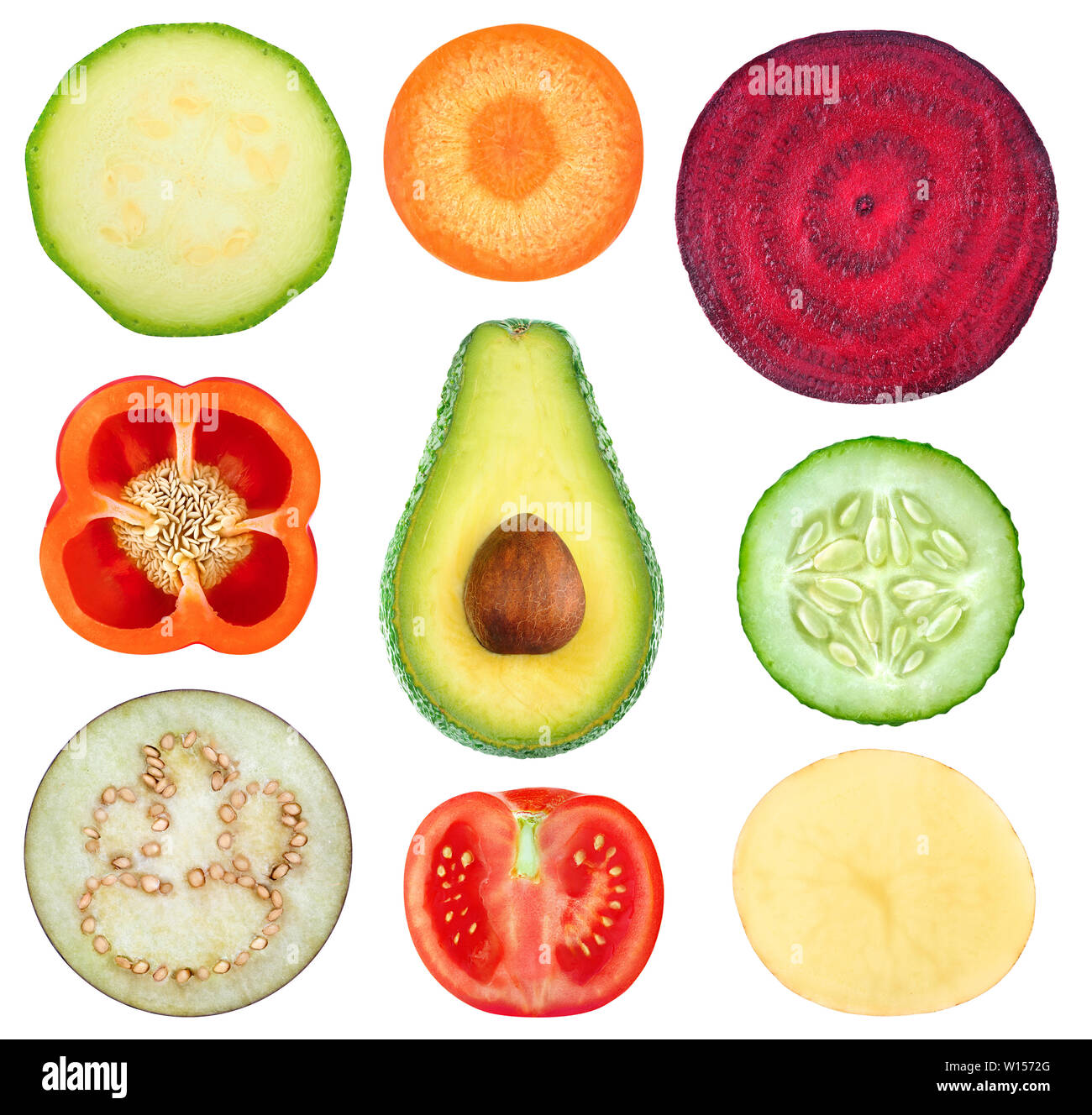 Isolated vegetable slices. Collection of fresh cut vegetables (zucchini, carrot, beetroot, bell pepper, avocado, cucumber, eggplant, tomato, potato) i Stock Photo