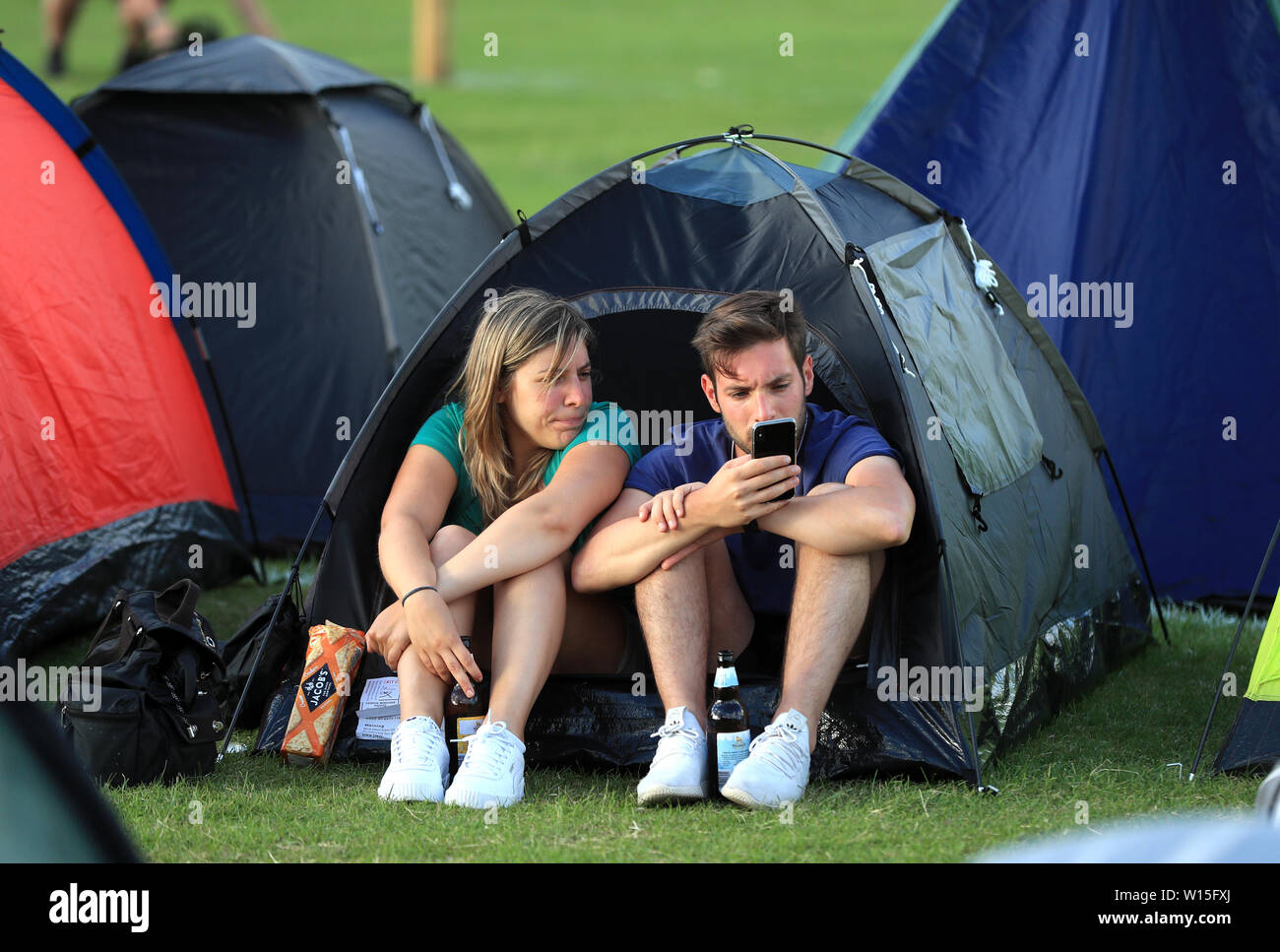 Campers queue for the first day of the 2019 Wimbledon Championships at the All England Lawn Tennis and Croquet Club, London. Stock Photo