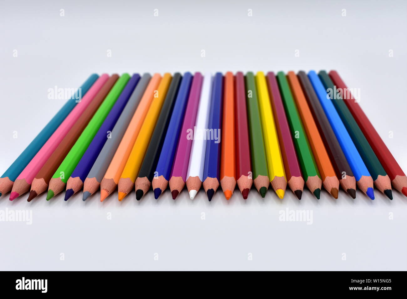 Wooden pencils with colours on a white background. - Stock Image