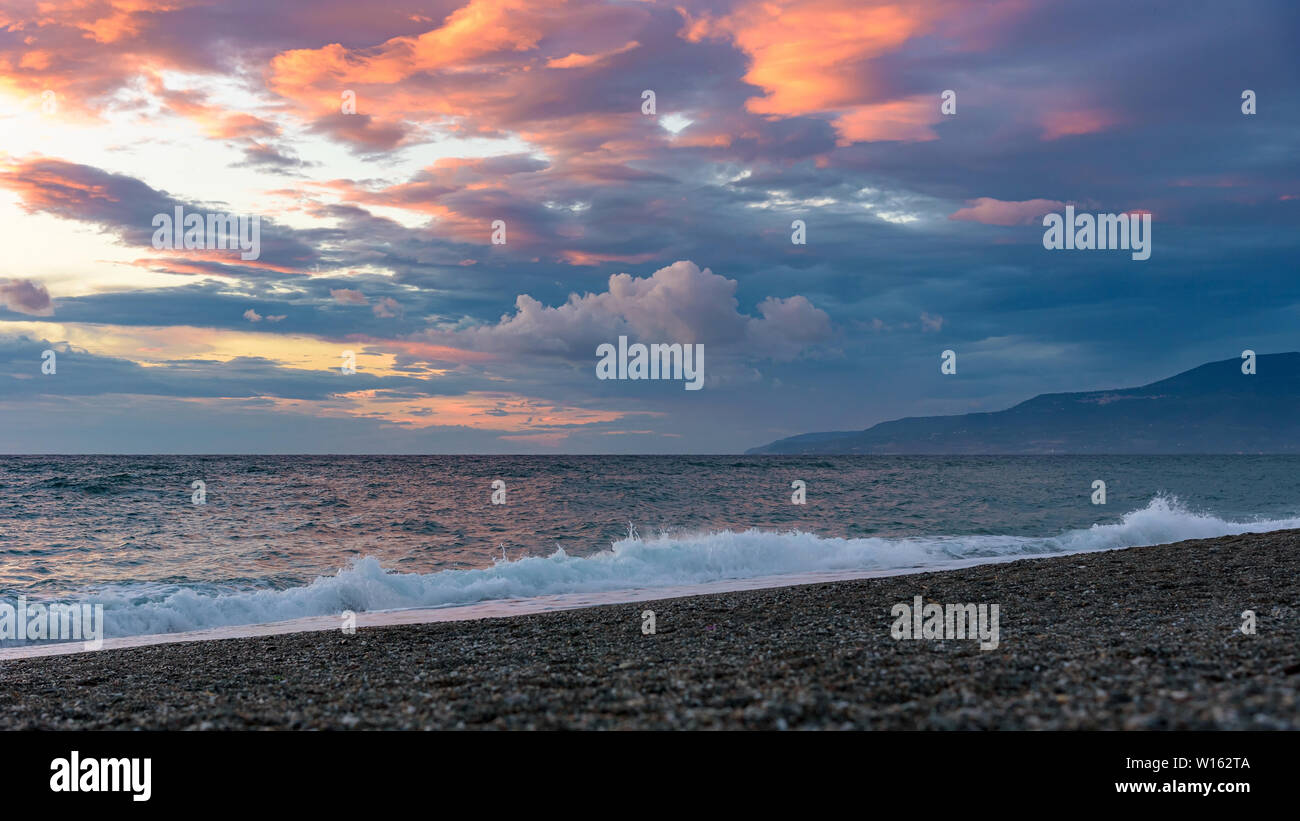 Picturesque sunset on the Calabrian beach in Italy Stock Photo