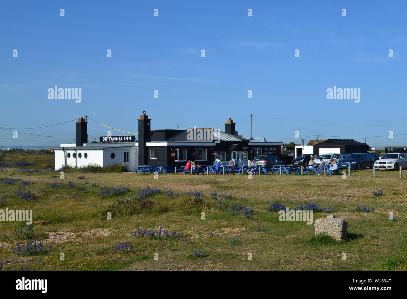The Britannia Pub, famous for its fish and chips and great ice cream, Dungeness, Kent, on a hot summer's day - Stock Image