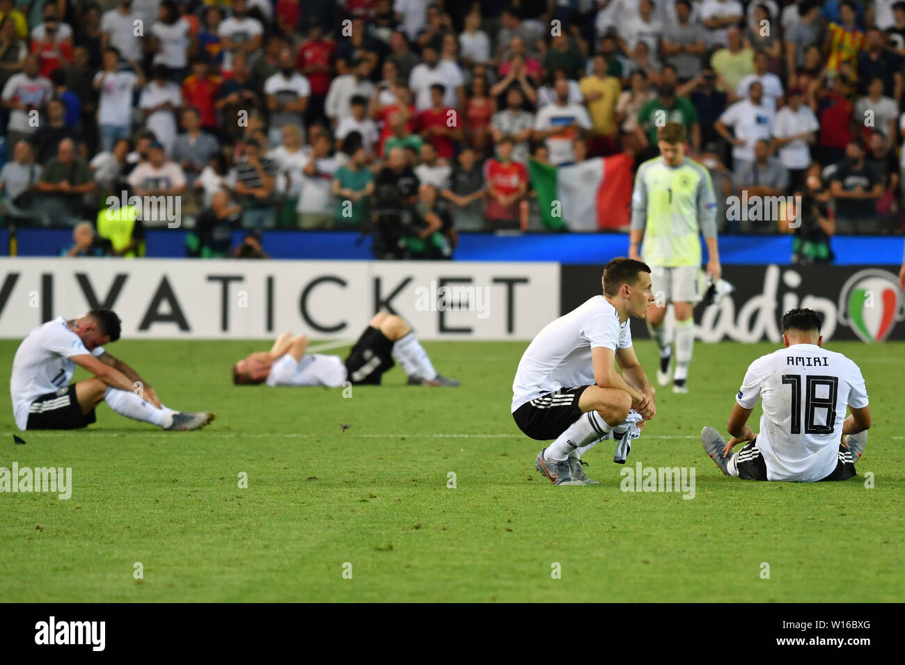Udine, Italien. 30th June, 2019. German players after the final whistle on the ground destroyed, disappointment, frustrated, disappointed, frustratedriert, dejected, Spain (ESP) - Germany (GER) 2-1, at 30.06.2019 Stadio Friuli Udine. Football U-21, FINALE UEFA Under21 European Championship in Italy/SanMarino from 16.-30.06.2019. | Usage worldwide Credit: dpa/Alamy Live News - Stock Image