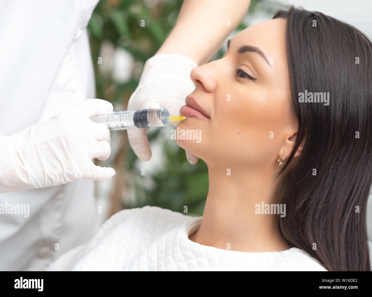 Filler injection for face  Plastic aesthetic facial surgery  Doctor
