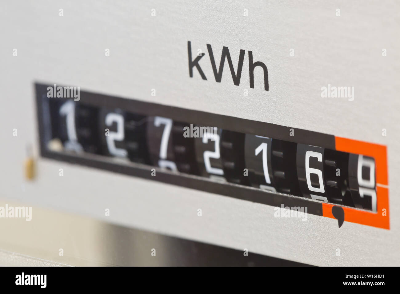 Close up of electric meter reader showing used kWh in private residential home with selective focus - Stock Image