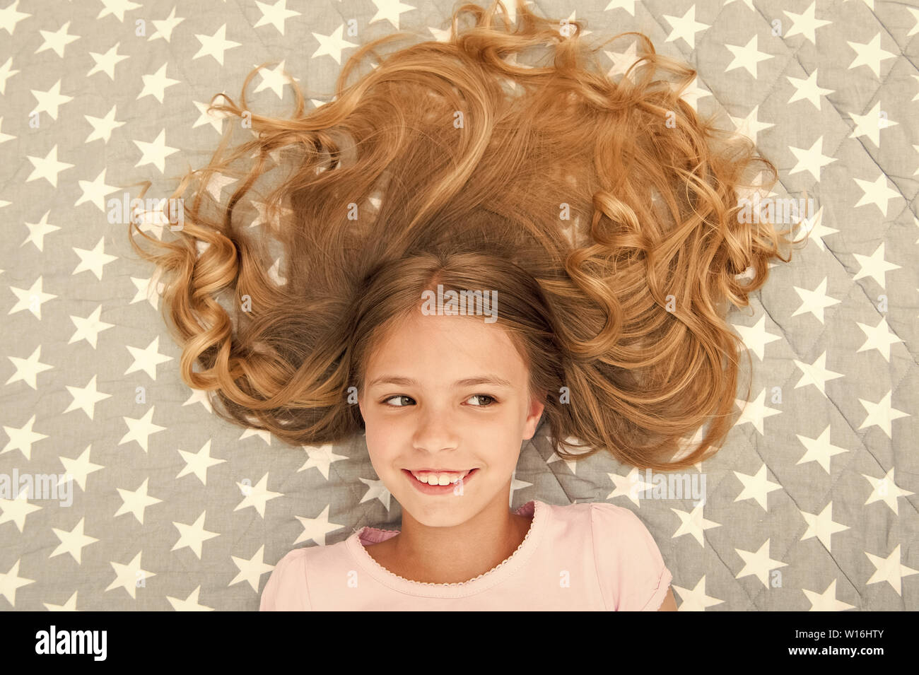 Child curly hairstyle relaxing. Conditioner mask organic oil ...