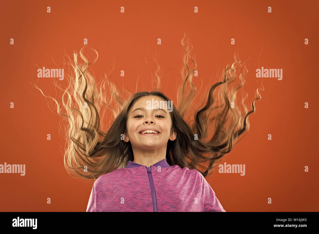Small girl child. Hairdresser for kids. childrens day. Portrait of happy little child. Kid fashion and sportswear. childhood happiness. Family. Happy little girl with long hair. I wish. Stock Photo
