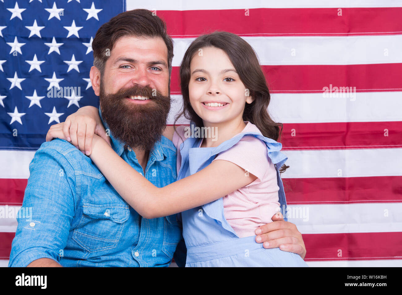 Father american bearded hipster and cute little daughter with USA flag. Freedom fundamental right. Independence is happiness. Independence day holiday. How do americans celebrate independence day. - Stock Image