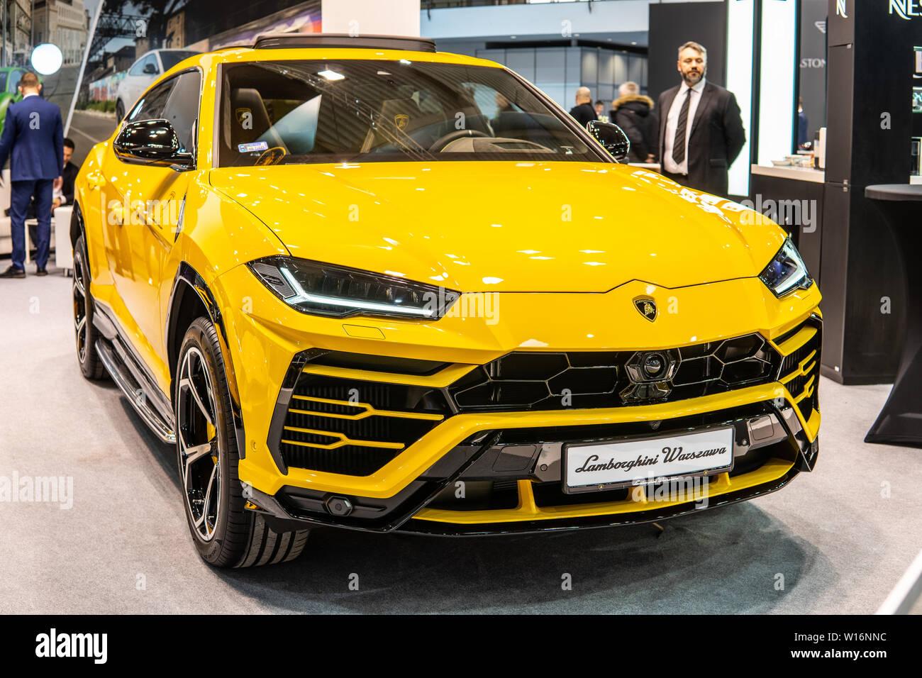 Poznan, Poland, March 2019 metallic yellow Lamborghini Urus
