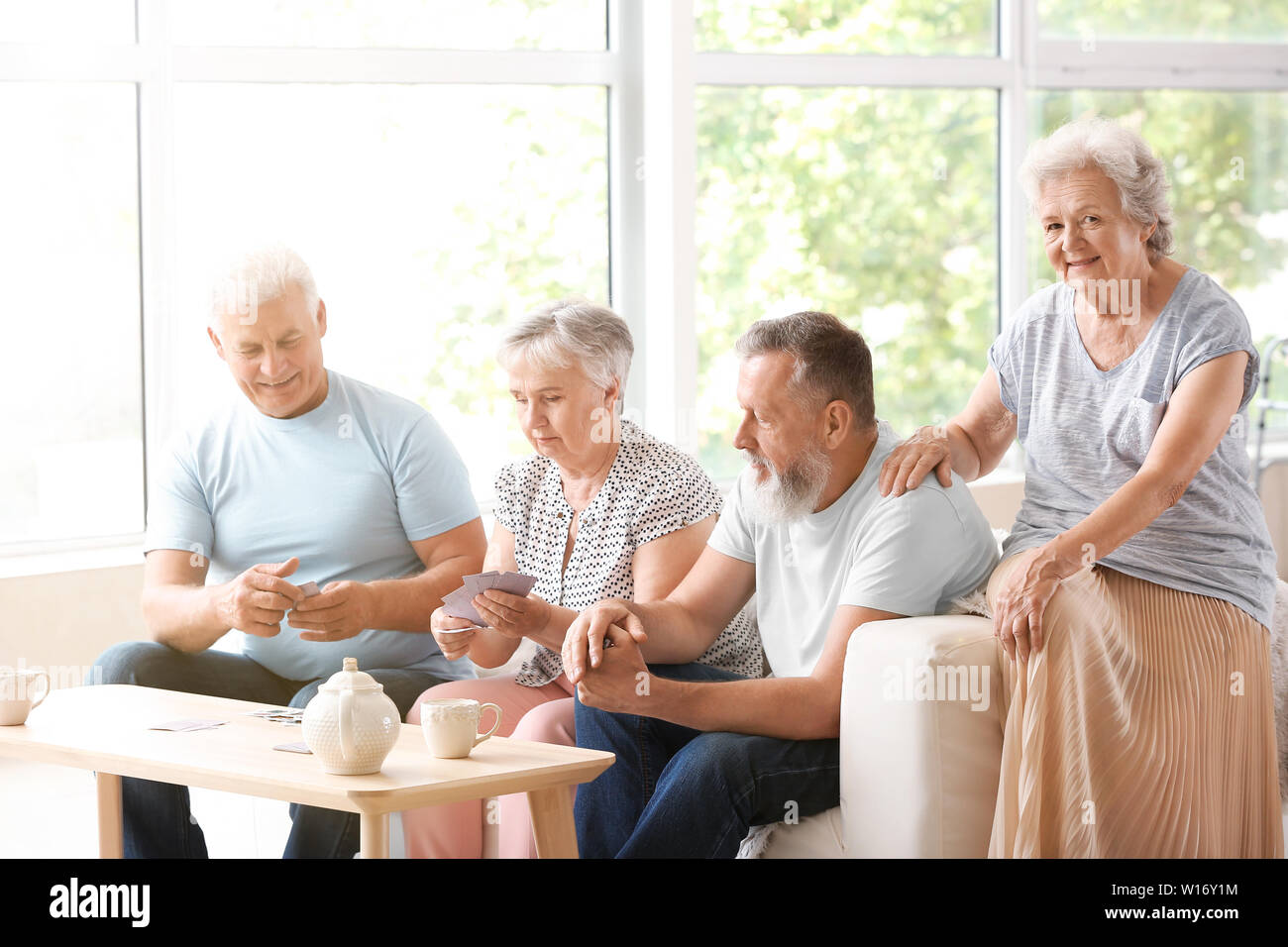 Portrait Of Elderly People Playing Cards In Nursing Home Stock Photo Alamy