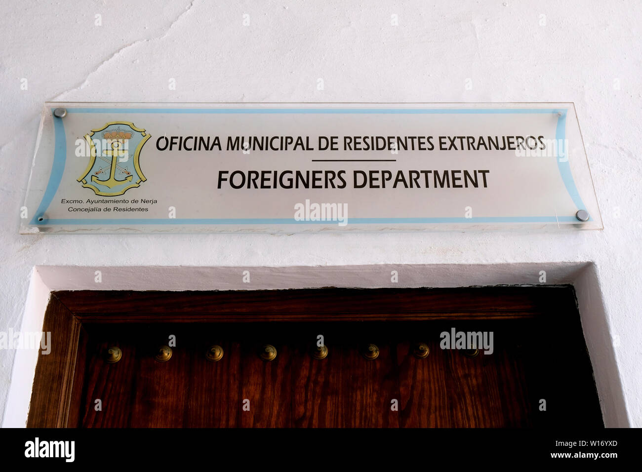 Sign above the Foreigners Department (Oficina Municipal de Residentes Extranjeros) in Nerja Spain; assistance for foreigners living and visiting Spain - Stock Image