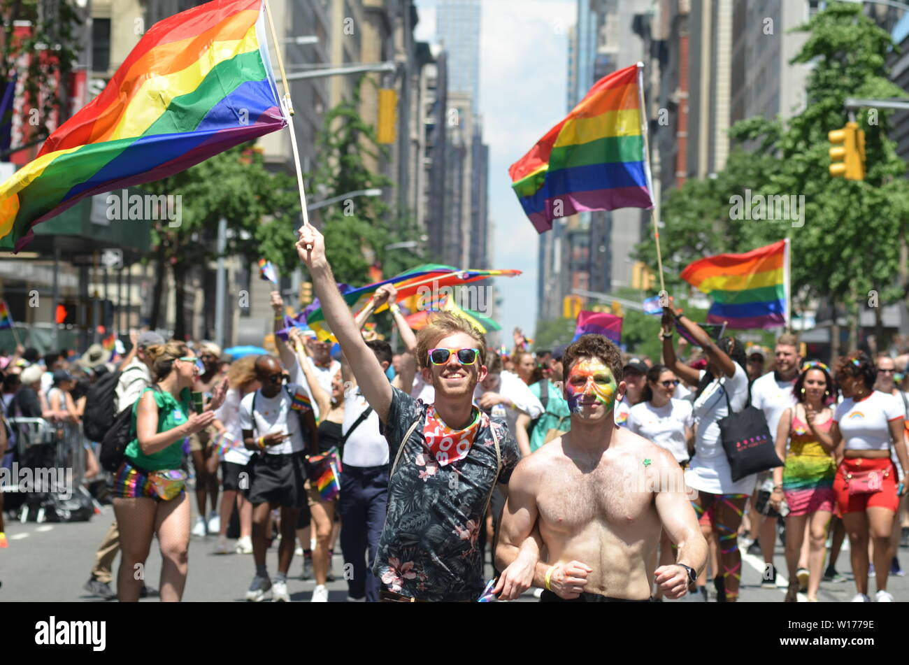 Millions of people from New York and all around the world participated at the World Pride Parade along Fifth Avenue in New York City on June 30, 2019. - Stock Image