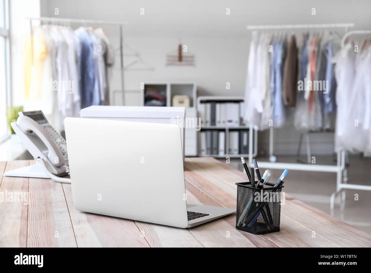 Brilliant Laptop On Table In Modern Dry Cleaners Stock Photo Interior Design Ideas Tzicisoteloinfo