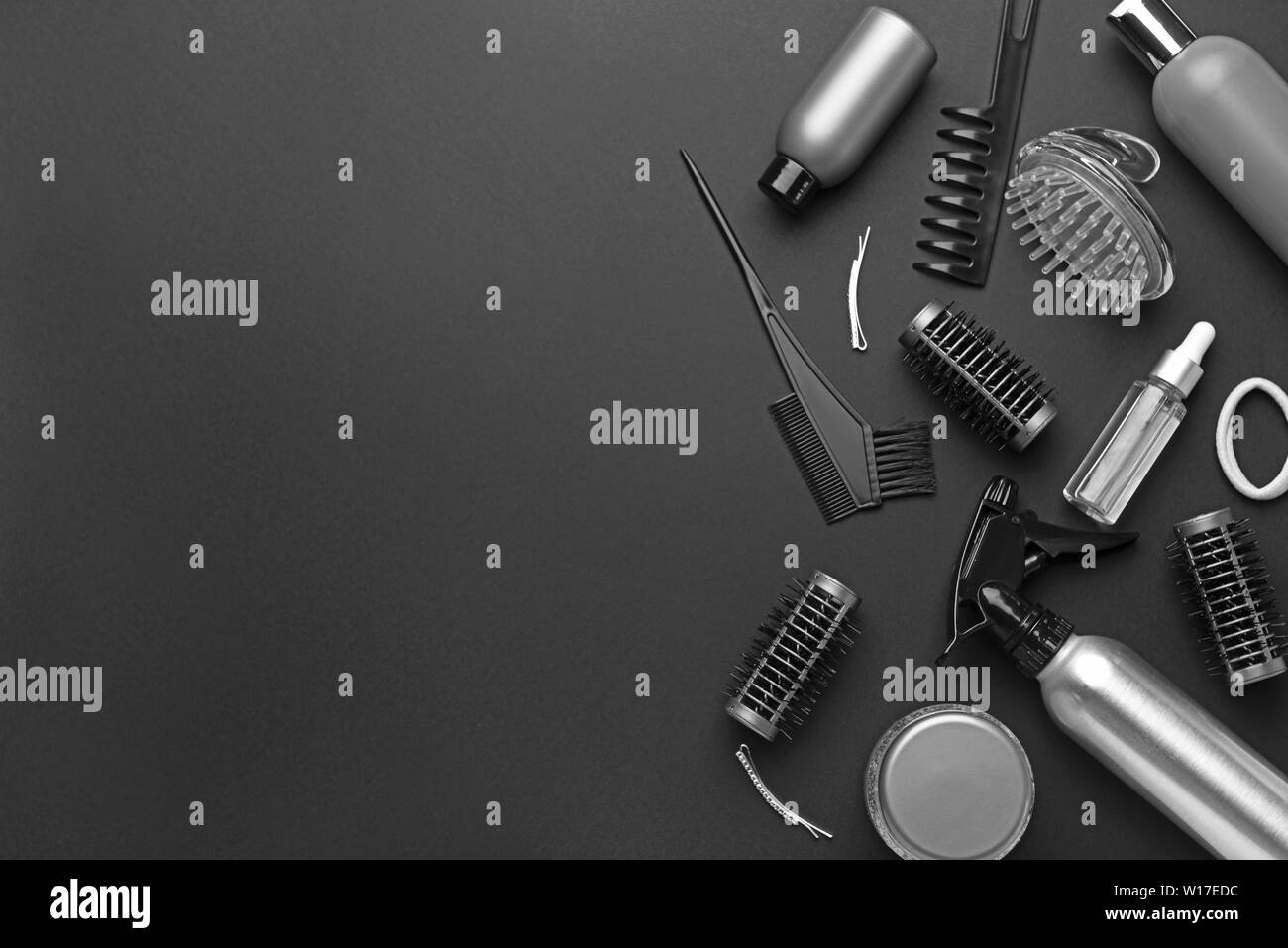 Set of hairdresser tools and accessories on dark background Stock Photo