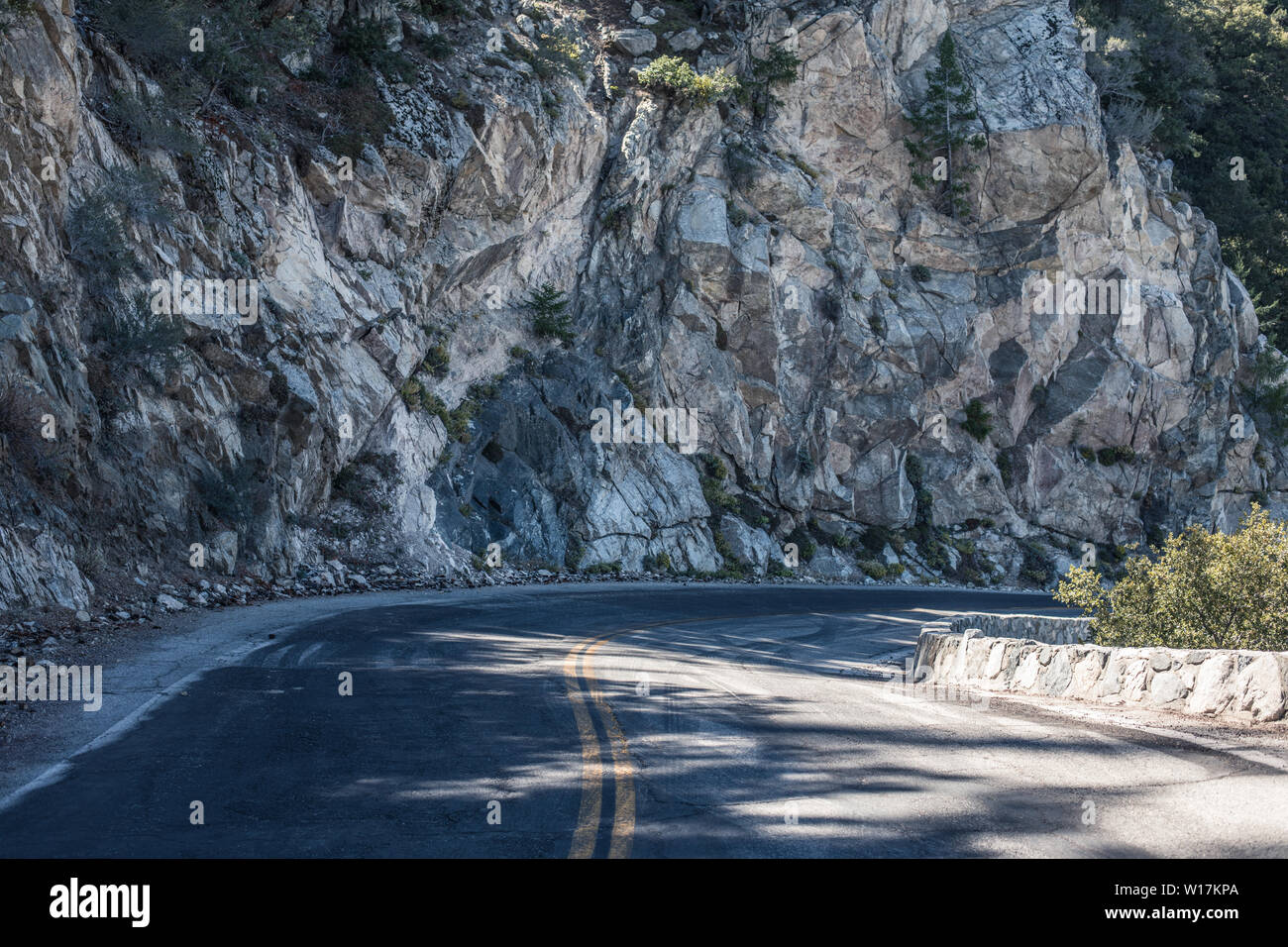 Spectacular serpentine of the rocky road on mountain Wilson, San Gabriel Mountains, California Stock Photo