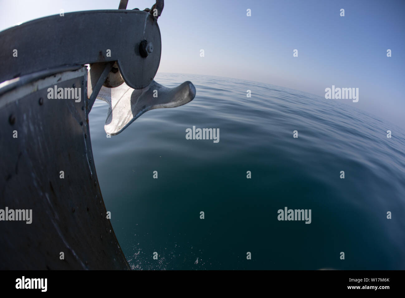 A bow of a boat on a calm ocean surface on a clear day Stock Photo