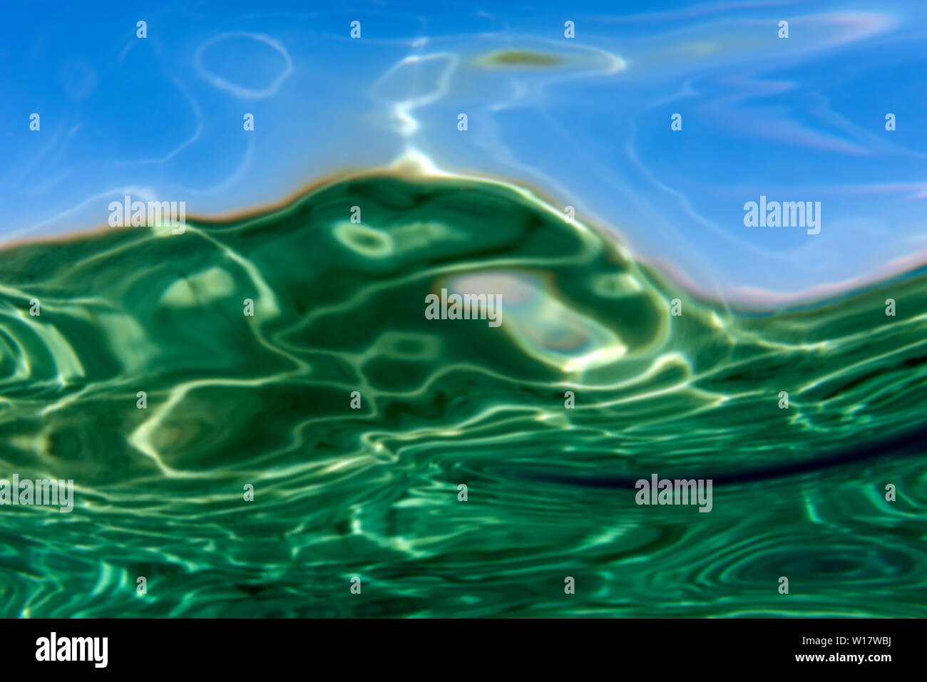 Summer time under the sea ocean water with a ray of sunlight from the surface for a background concept design Stock Photo