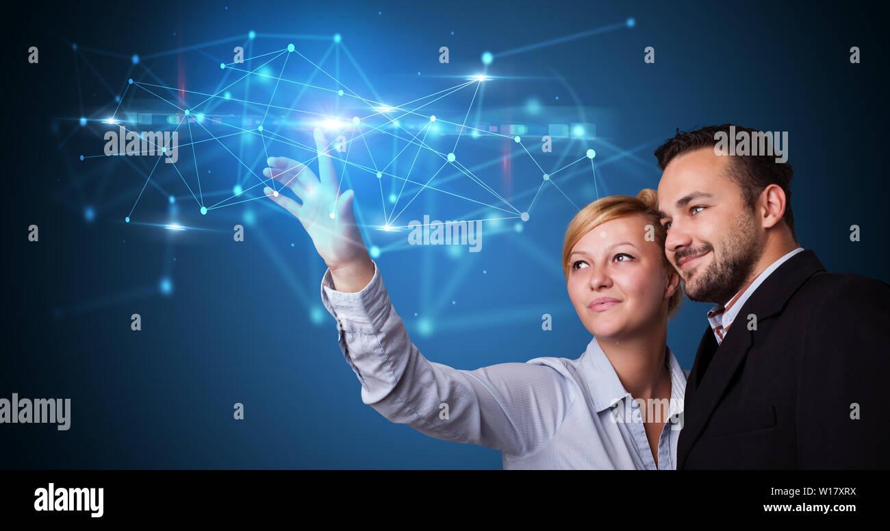 Man and woman touching hologram screen displaying modern web system  Stock Photo