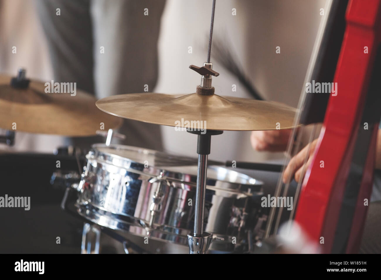 Live music background, drum set and red electric double bass