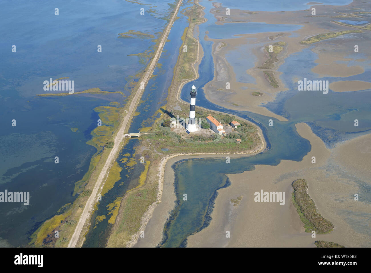 FARAMAN LIGHTHOUSE ON THE SEASHORE OF THE CAMARGUE REGION IN THE RHONE DELTA (height: 43m) (aerial view). Arles, Provence, France. - Stock Image